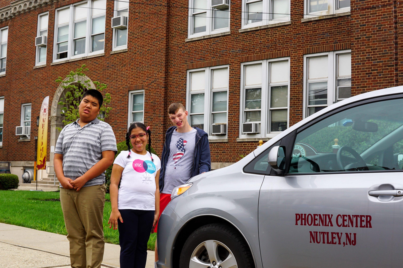 TPC Students next to school van