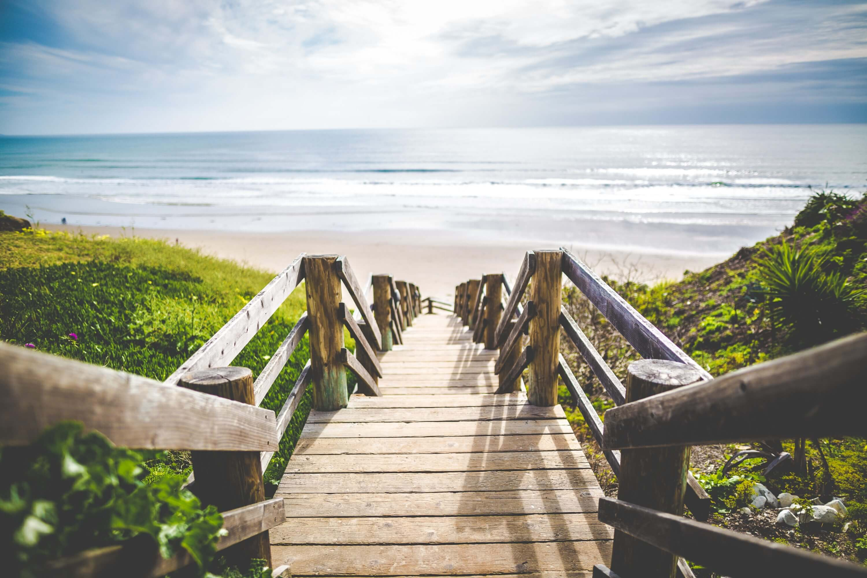 Wooden stairs leading down towards beach